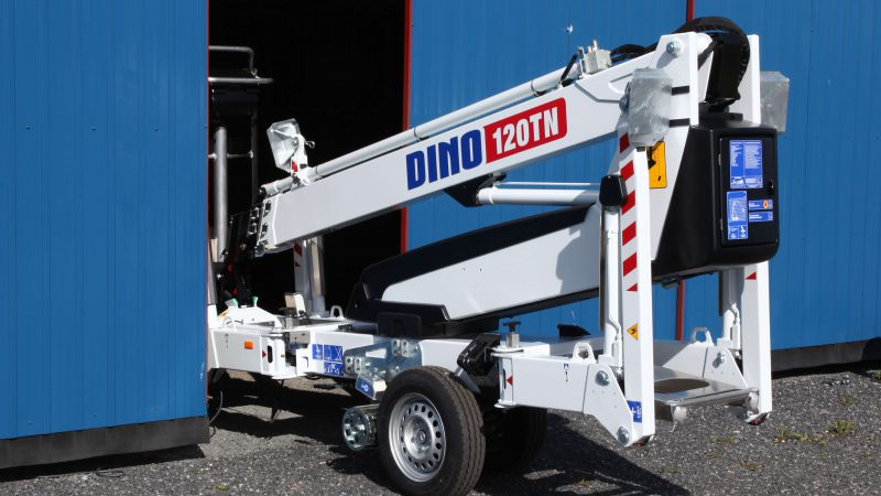 The DINO 120TN access platform fitting through a narrow gap.