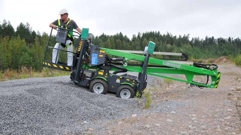 The Leguan 125 access platform being used on rough terrain.