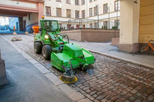 Avant Loader with road sweeper attachment.