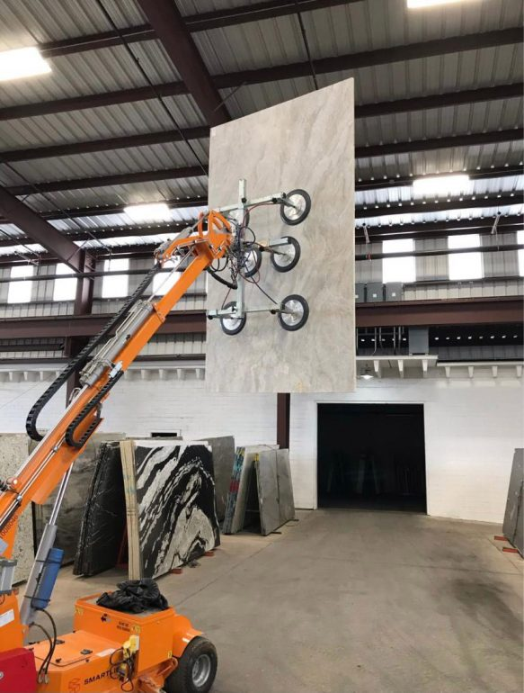 A granite worktop being lifted by a Smartlift.