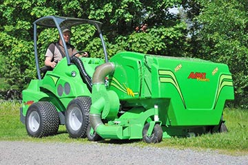 A lawnmower attachment on an Avant loader.