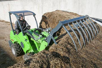A silage grab attached to an Avant loader.
