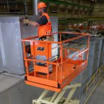 A slab scissor lift in use.