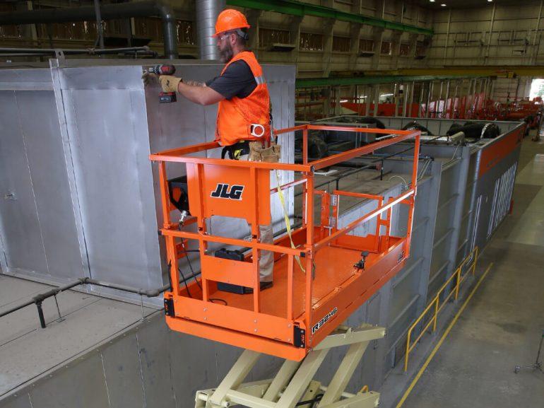 A JLG slab scissor lift in use.