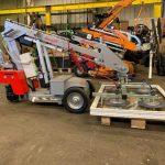 Smartlift glazing robots for lifting glass doors.